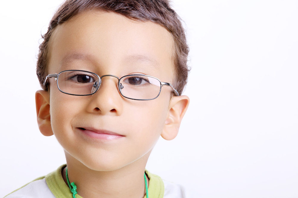 a child wearing new eyeglasses